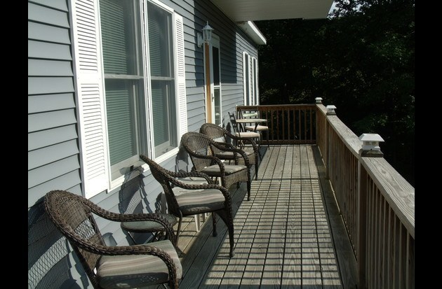 Wrap around porch with plenty of seating
